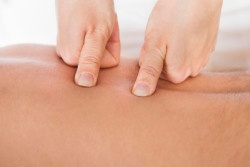 Close-up Of Person Receiving Shiatsu Treatment From Massager