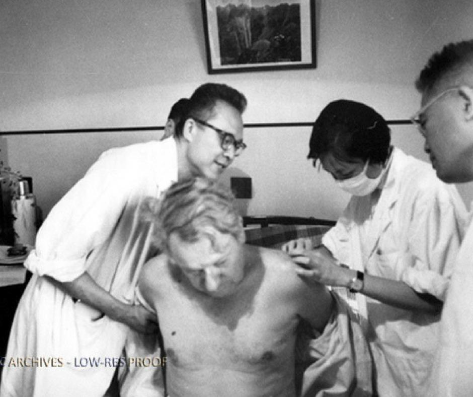 James Reston receiving acupuncture